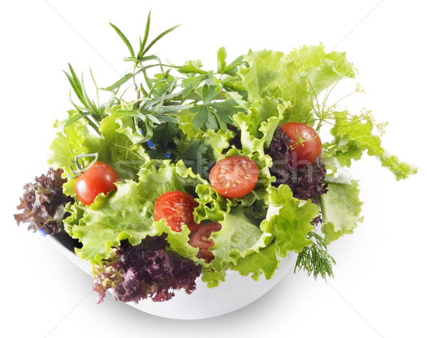 Mixed greens with cherry tomatoes. Isolated with clipping path Stock photo © Wikki