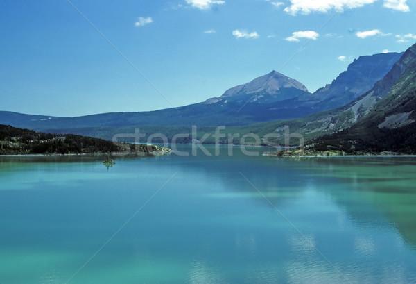 A lone peak with an alpine lake Stock photo © wildnerdpix