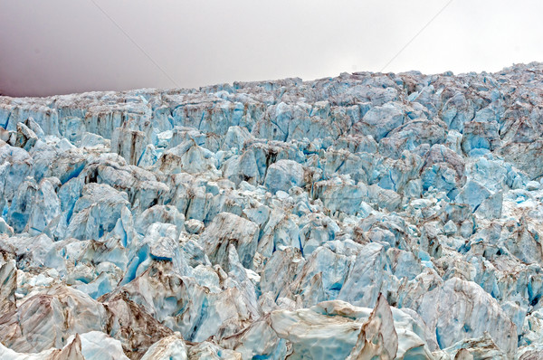 Blue ice at a Glacial Ice fall Stock photo © wildnerdpix