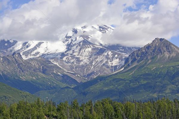 Stock photo: Volcanic Mountain Peeking Through the Clouds