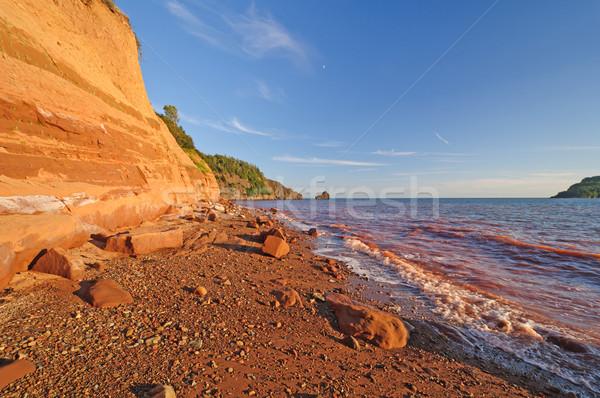 Sandstone beach in Evening Light Stock photo © wildnerdpix