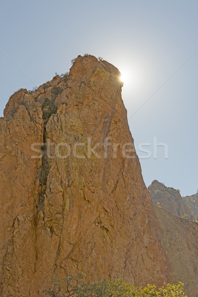 Desert Sun Peeking Around a Rock Monolith Stock photo © wildnerdpix
