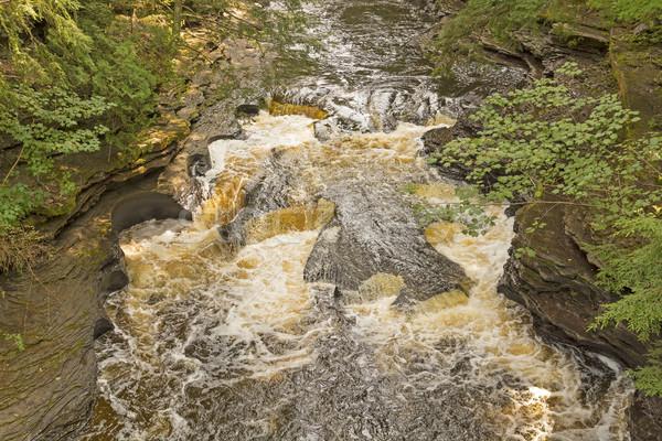Rushing Water over Unusual Rocks Stock photo © wildnerdpix