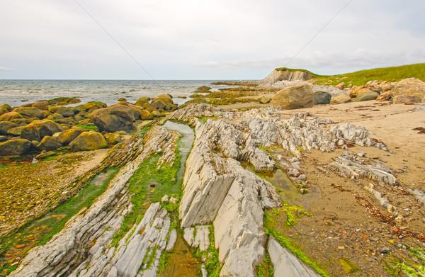Rocas arena remoto costa escoba punto Foto stock © wildnerdpix