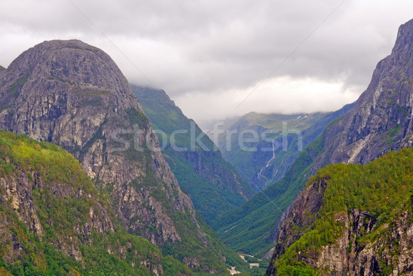 Clouds hanging over a mountain valley Stock photo © wildnerdpix