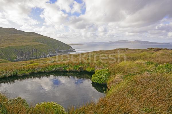 Színes tájkép távoli sziget duda óceán Stock fotó © wildnerdpix