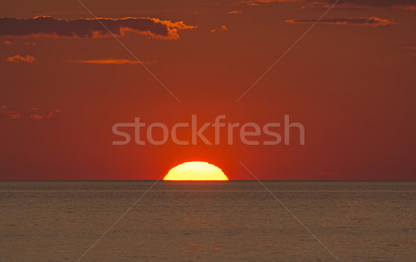 Sun Setting into the Ocean Stock photo © wildnerdpix