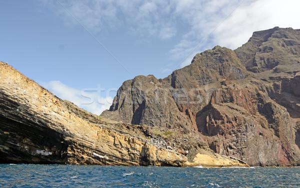 Egyenetlen sziklák vulkáni sziget óceán hegyek Stock fotó © wildnerdpix