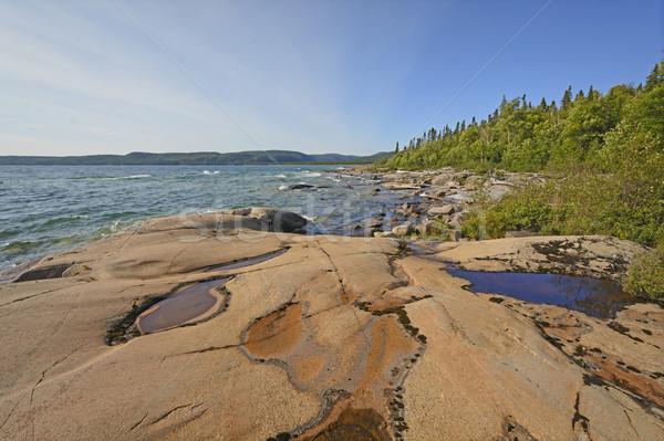 Eau roches solitaire côte parc Photo stock © wildnerdpix