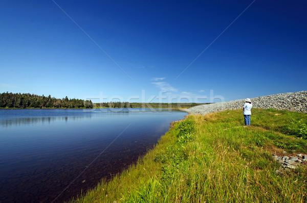 Hiker looking at a coastal lagoon Stock photo © wildnerdpix