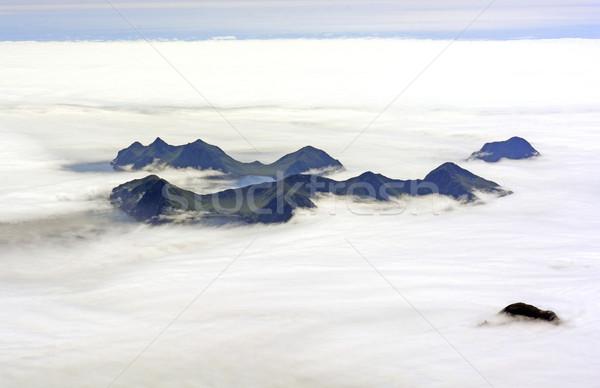 Aerial View of an Island Poking Through Ocean Fog Stock photo © wildnerdpix