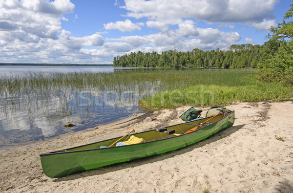Loading the Canoe on Shore Stock photo © wildnerdpix