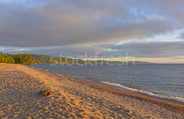 Stock photo: Evening Shadows on a Gravel Beach