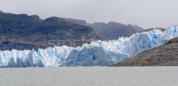 Blue Glacial Ice meeting a Glacial Lake Stock photo © wildnerdpix