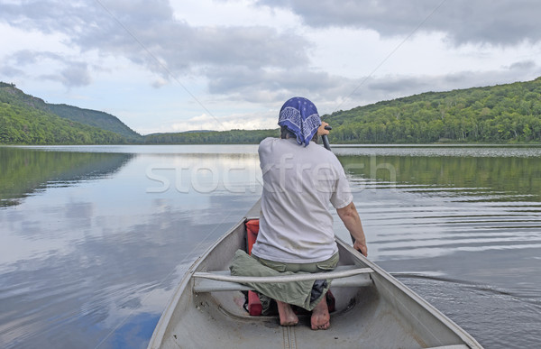 Barefoot Paddler on a Calm Lake Stock photo © wildnerdpix