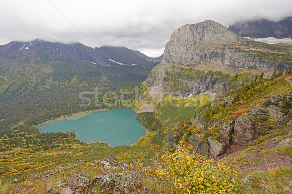 Guardando verso il basso alpino lago caduta ghiacciaio parco Foto d'archivio © wildnerdpix