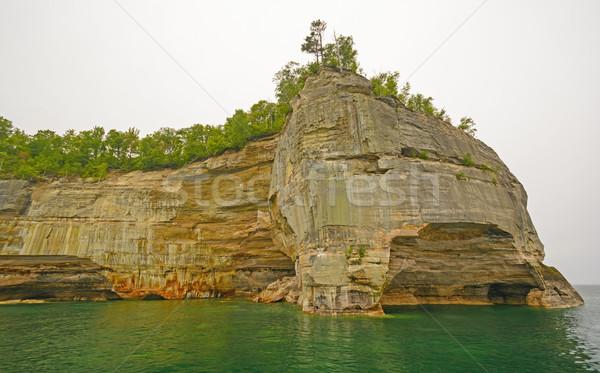 Rock Ridge into the Lake Stock photo © wildnerdpix