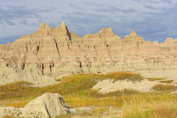 Stock photo: Colorful Badlands Formations Against Stormy Skies