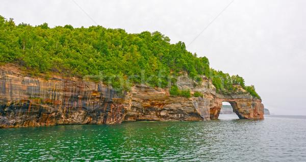 Meer Bogen farbenreich Klippen Felsen Seeufer Stock foto © wildnerdpix
