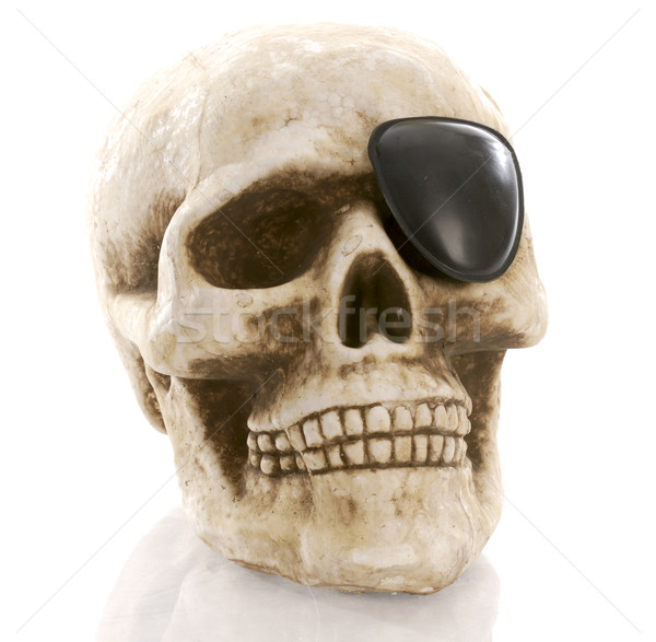 human skull with eye patch on white background Stock photo © willeecole