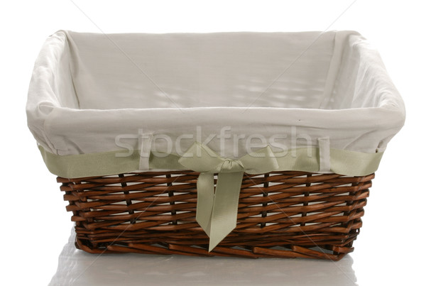 fabric lined wicker basket with bow isolated on white background Stock photo © willeecole