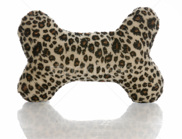 leopard print stuffed dog bone with reflection on white background Stock photo © willeecole