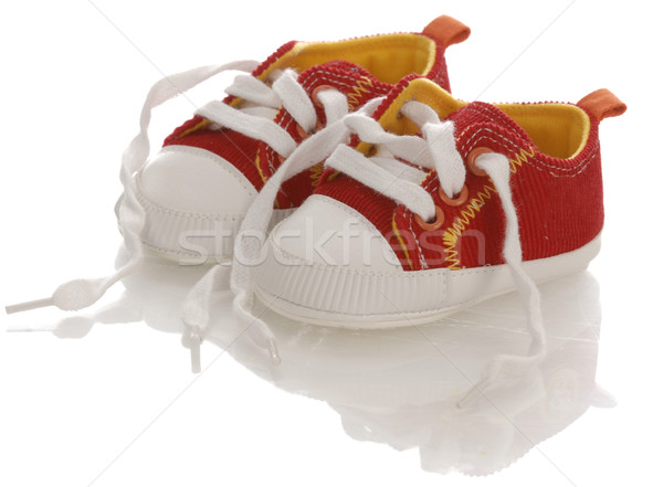 red baby on infant running shoes with laces untied Stock photo © willeecole