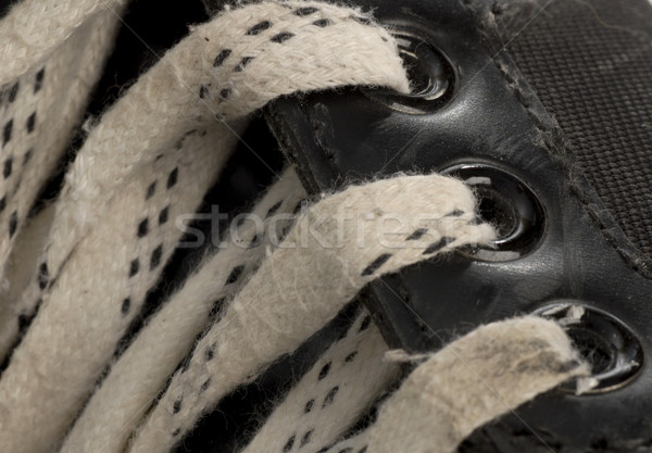 laces details on pair of worn hockey skate Stock photo © willeecole