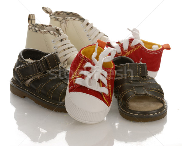 pile of baby or infant shoes with reflection on white background Stock photo © willeecole