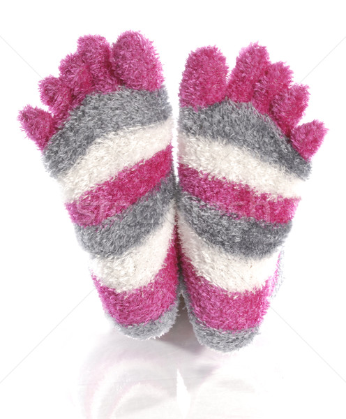 pink fuzzy toe socks with reflection on white background Stock photo © willeecole