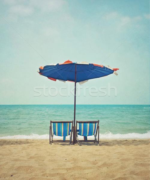 Plaży w stylu retro krzesła parasol niebo wody Zdjęcia stock © winnond