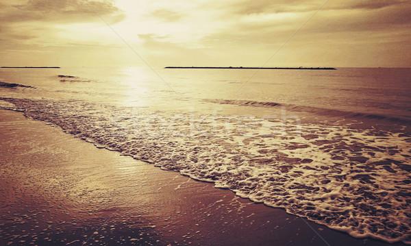 レトロな 日の出 ビーチ レトロスタイル 水 日没 ストックフォト © winnond