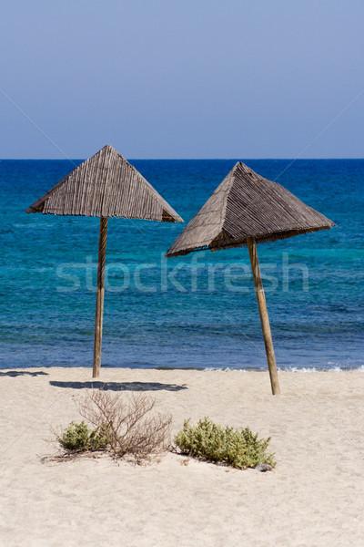 Nap elleni védelem kettő magányos nap esernyők tengerpart Stock fotó © winterling