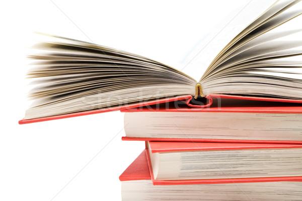 Open boek top verscheidene geïsoleerd witte Stockfoto © winterling