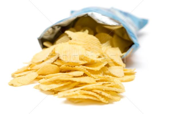 Zak chips gouden chips geïsoleerd witte Stockfoto © winterling