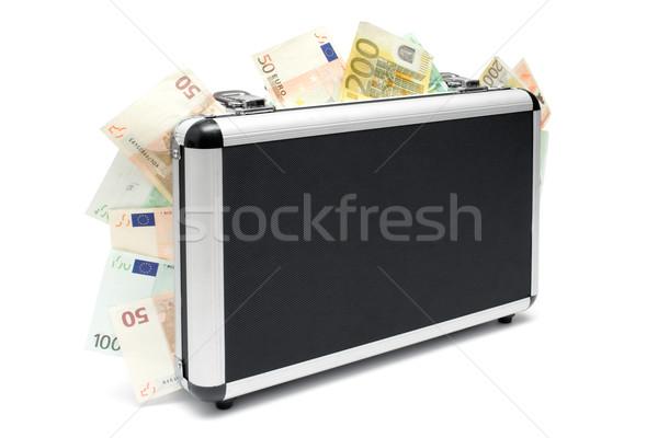 Geld koffer permanente geval vol Stockfoto © winterling
