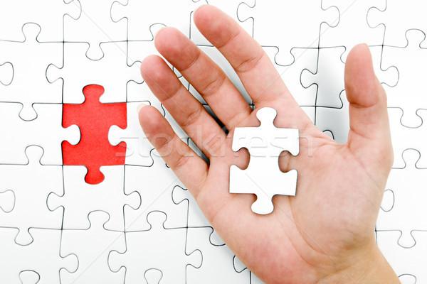 Holding a Jigsaw Piece Stock photo © winterling