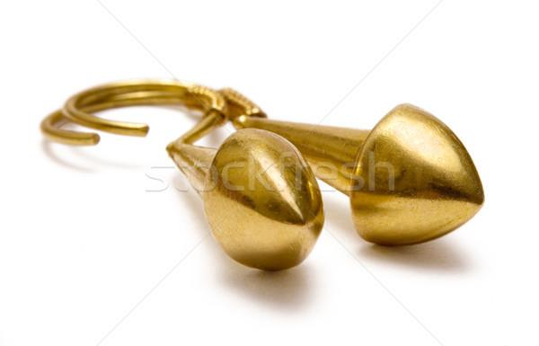 Gouden oorbellen paar geïsoleerd witte metaal Stockfoto © winterling