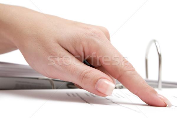 Wijzend document vrouwelijke wijsvinger business bestand Stockfoto © winterling