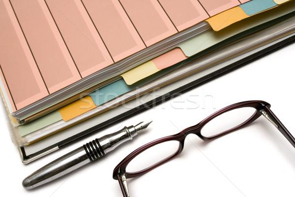 Folderze pióro okulary biały działalności Zdjęcia stock © winterling