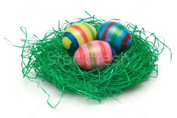 Três ovos de páscoa grama colorido ovos grama artificial Foto stock © winterling