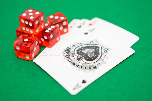 Zarlar aces kırmızı yalıtılmış yeşil poker Stok fotoğraf © winterling