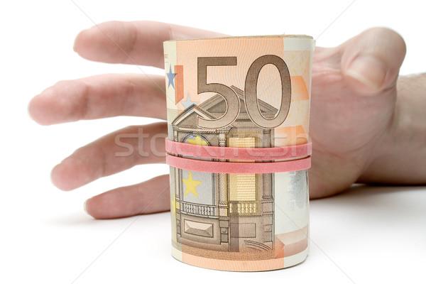 Rollen geld hand euro geïsoleerd Stockfoto © winterling