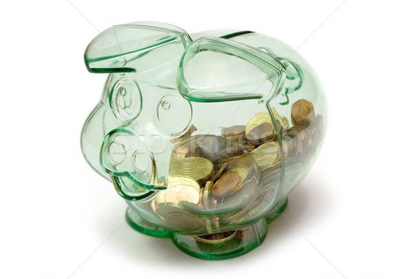 Transparant spaarvarken vol munten geïsoleerd witte Stockfoto © winterling