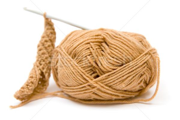 Szydełkować brązowy przędzy hak biały tkaniny Zdjęcia stock © winterling