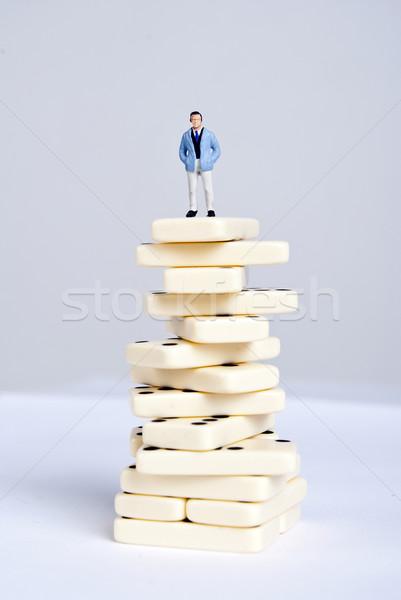 Dominó egy férfi áll köteg kockák Stock fotó © wisiel