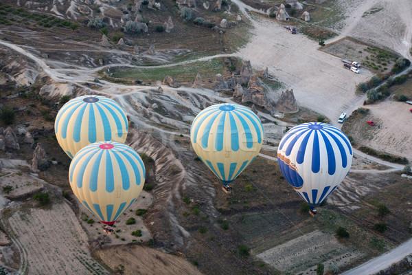 Forró levegő napfelkelte legnagyszerűbb turisztikai attrakció repülés Stock fotó © wjarek