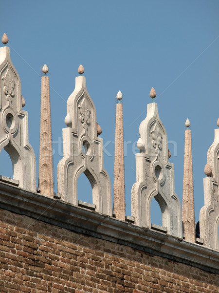 Characteristic architectural ornaments on the edge of a roof of the Doges' Palace in Venice Stock photo © wjarek
