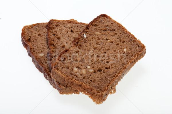 Slices of dark bread isolated over white  Stock photo © wjarek