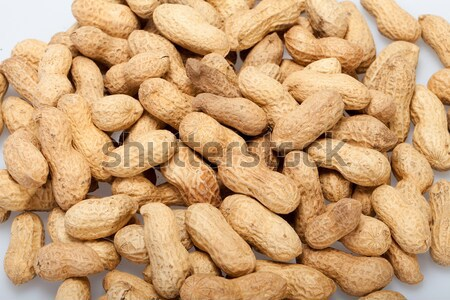 Dried peanuts in closeup on the white background Stock photo © wjarek